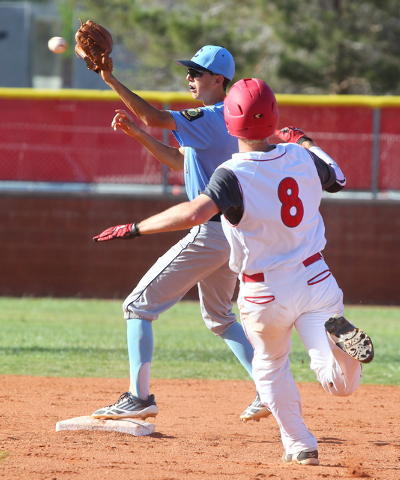 Centennial's Jacob Horton forces Arbor View's Kevin Johns (8) at second in the Sunset Region baseball tournament on Wednesday. Centennial won, 4-2. (Chase Stevens/Las Vegas Review-Journal)
