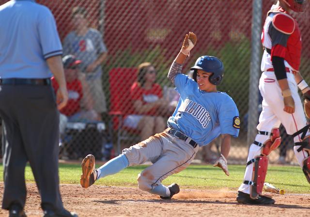 Centennial's Tanner Wright slides safely into home against Arbor View during the Sunset Region baseball tournament on Wednesday. Centennial won, 4-2. (Chase Stevens/Las Vegas Review-Journal)