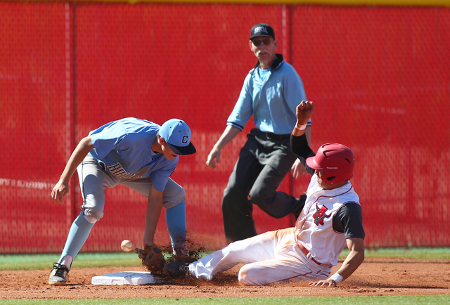 Centennial's Kyle Horton, left, loses the ball as Arbor View's Nick Quintana slides safely into third base during the Sunset Region baseball tournament on Wednesday. Centennial won, 4-2. (Chase St ...