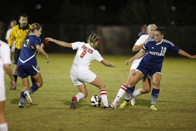 Arbor View's Breanna Larkin (8) controls the ball between Shadow Ridge's Sasha Villa (10) and Joey Wright during the Sunset Region semifnals on Thursday. The Aggies won, 2-1. (Donavon Lockett/Las  ...