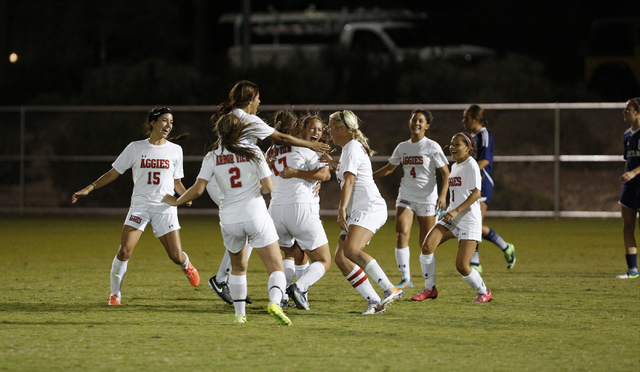 Arbor View players celebrate after a goal during the Sunset Region semifinals on Thursday. The Aggies beat Shadow Ridge, 2-1. (Donavon Lockett/Las Vegas Review-Journal)