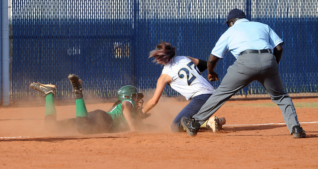 Rancho's Kayla Coles, left, slides in under the tag of Foothill's Katelyn Enzweiller in the second inning of the Sunrise Region softball tournament winners' bracket final Thursday. Host Foothill w ...