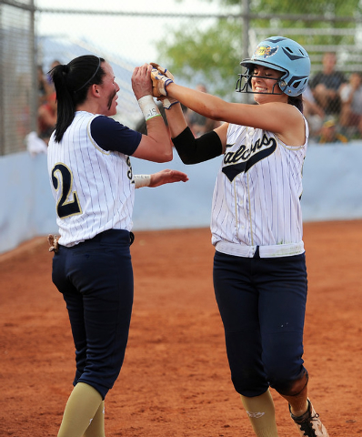 Foothill's RaeAnn Brems (2) congratulates teammate Katelyn Enzweiller after she scored the go-ahead run in the fourth inning of the Sunrise Region softball tournament winners' bracket final Thursd ...
