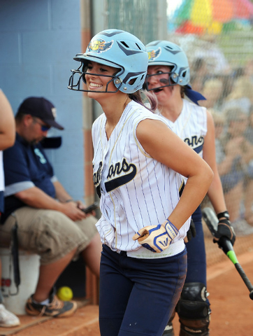 Foothill's Katelyn Enzweiller smiles after scoring the go-ahead run in the fourth inning of the Sunrise Region softball tournament winners' bracket final Thursday at Foothill. The Falcons defeated ...