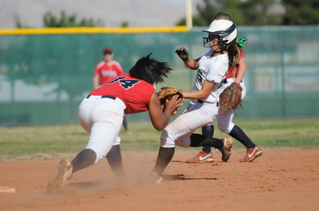 Coronado's Jaiden Johnson (14) tags Rancho's Kat Anthony (27) for an out during the Sunrise Region tournament on Wednesday. Rancho won, 3-2. (Erik Verduzco/Las Vegas Review-Journal)