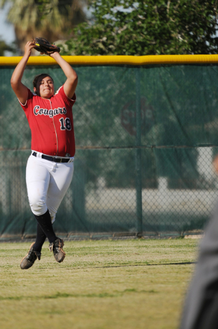 Coronado's Jillian James (18) jumps to make a catch in the outfield on Wednesday against Rancho in the Sunrise Region tournament. Rancho won, 3-2. (Erik Verduzco/Las Vegas Review-Journal)