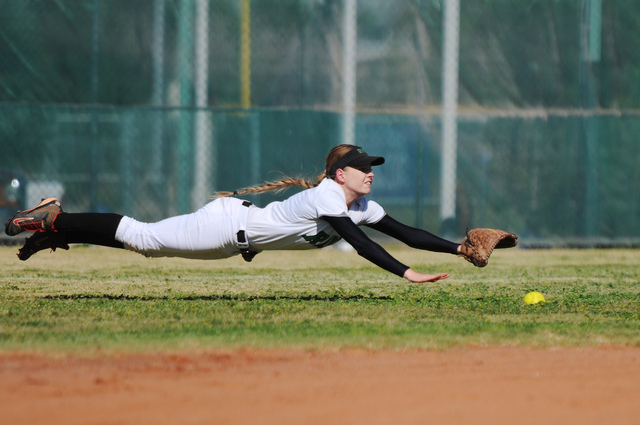 Rancho's Sam Megan Sloan (7) can't come up with a diving catch against Coronado in the Sunrise Region tournament. Rancho won 3-2. (Erik Verduzco/Las Vegas Review-Journal)