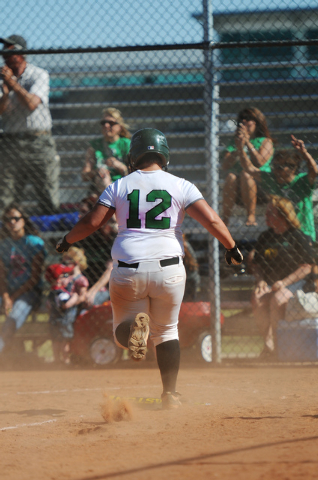 Rancho's Jacey Kelley (12) scores a run in the Rams 3-2 win over Coronado on Wednesday. (Erik Verduzco/Las Vegas Review-Journal)