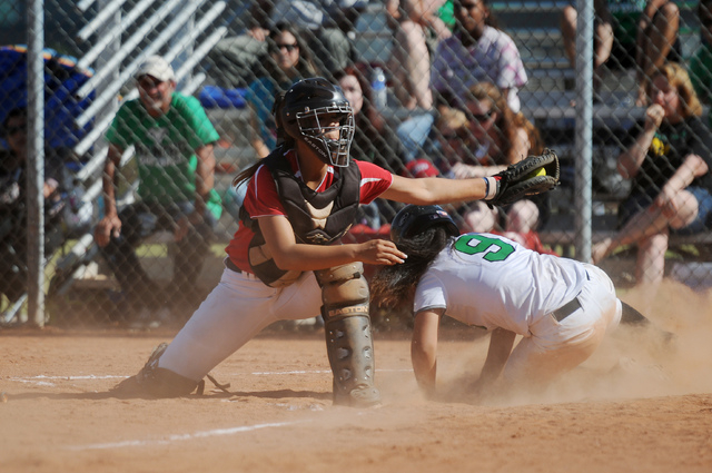 Rancho's Sammi Llamas (9) beats the tag by Coronado catcher Basia Query (9) in the Sunrise Region tournament on Wednesday. Rancho won, 3-2. (Erik Verduzco/Las Vegas Review-Journal)