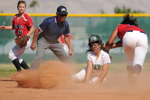 Rancho's Sammi Llamas (9), center, beats the tag by Jaiden Johnson (14) at second base during the Sunrise Region tournament on Wednesday. Rancho won, 3-2. (Erik Verduzco/Las Vegas Review-Journal)