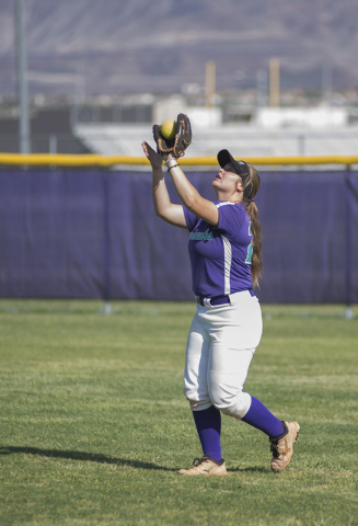 Silverado's Taryn Southerland (29) catches a fly ball against Rancho during the first round game of the Sunrise Regional tournament played at Silverado's softball field in Las Vegas on Tuesday, Ma ...