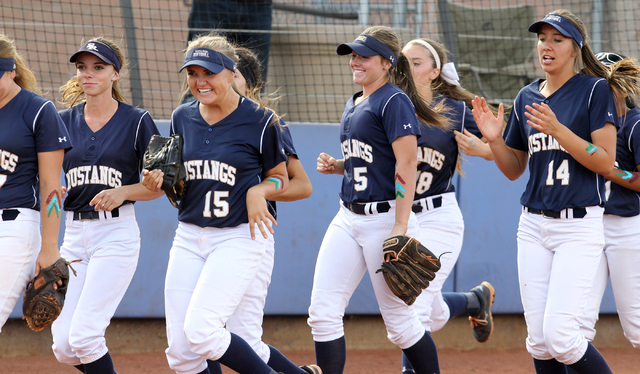 Shadow Ridge players rush toward home place after senior Justin Garganese (not shown) hit a solo home run against Palo Verde in the first inning of their Sunset Region softball tournament winners' ...