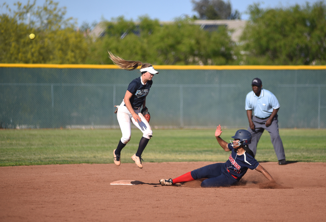 Coronado's Jaiden Johnson (11) slides into second base against Foothill's Kylie Becker (2) during their softball game at Coronado High School in Henderson on Wednesday, May 11, 2016. Coronado defe ...