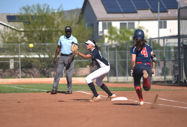 Foothill's Sarah Maddox (12) takes the throw to put out Coronado's Dylan Underwood (4) at first base during their softball game at Coronado High School in Henderson on Wednesday, May 11, 2016. Cor ...