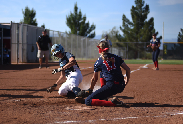 Coronado's Sarah Pinkston (17) tags out Foothill's Sarah Pinkston (12) at home plate during their softball game at Coronado High School in Henderson on Wednesday, May 11, 2016. Coronado defeated F ...