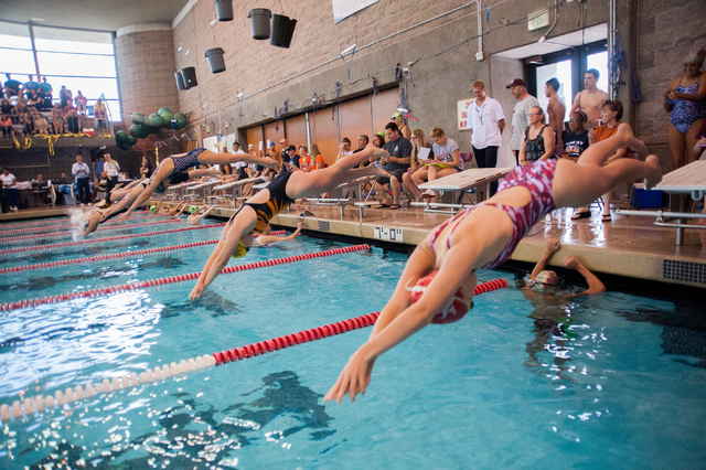 The girls dive in for the start of the 200-yard individual medley race at the Sunset Region meet on Saturday. (Martin S. Fuentes/Las Vegas Review-Journal)