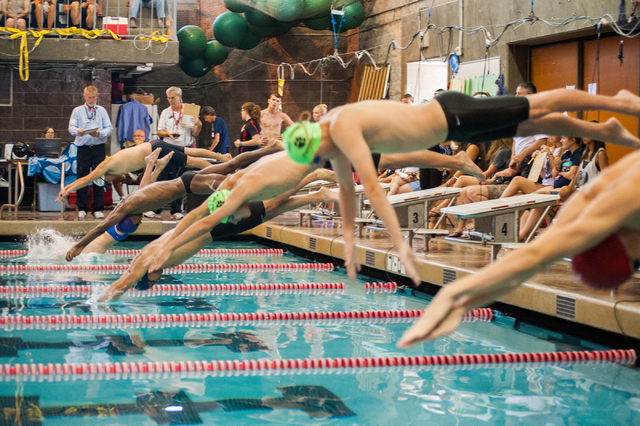 The boys dive in for the start of the 200-yard individual medley race at the Sunset Region meet on Saturday. (Martin S. Fuentes/Las Vegas Review-Journal)