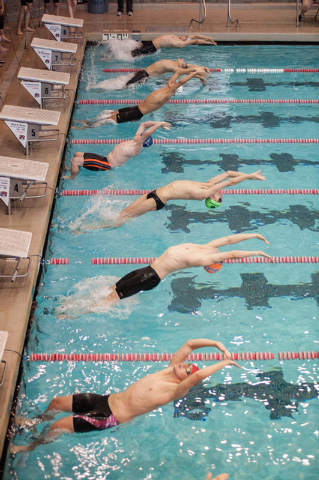 The boys dive in for the start of the 200-yard medley relay race at the Sunset Region meet on Saturday. (Martin S. Fuentes/Las Vegas Review-Journal)