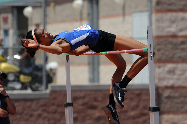 Vashti Cunningham of Bishop Gorman clears 6 feet, 4 inches during the girl's high jump competition during the NIAA Division I Sunrise and Sunset Region track and field meet at Del Sol High School  ...