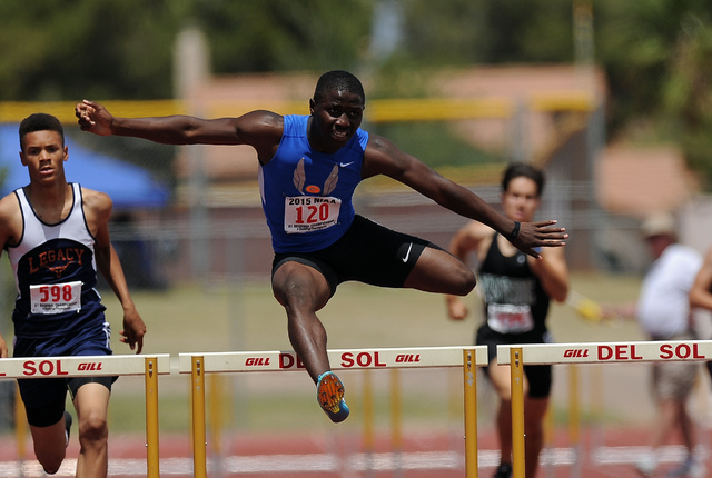 Tyjon Lindsey of Bishop Gorman wins a Sunset Region boy's 300-meter hurdle heat with a time 40.40 seconds during the Division I Sunset Region track and field meet at Del Sol High School in Las Veg ...