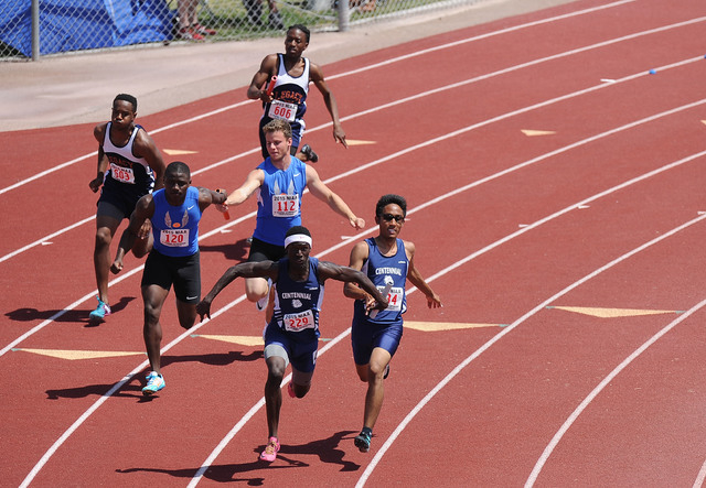 Teams from Centennial, right, Bishop Gorman, middle and Legacy are seen while competing in a boy's Sunset Region 400-meter relay heat race during the Division I Sunset Region track and field meet  ...