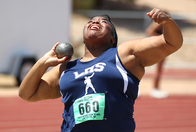 Liberty's Ashlie Blake competes in the girls shot put event Saturday. Blake set a Sunrise Region record with an effort of 50 feet, 0½ inches to win the event. (Chase Stevens/Las Vegas Review-Journal)