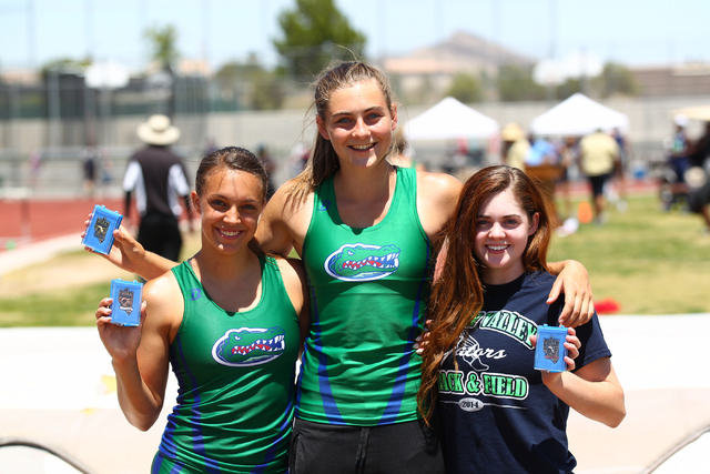 Green Valley pole vaulters, from left, McKenzie Gravo, Rachel Buck, and Sydney Eastwood, who placed second, first and third respectively, in the Sunrise Region girls pole vault event, pose with th ...