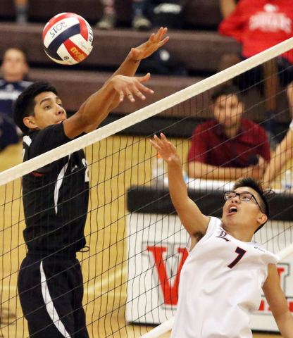 Rancho's Martin Rodriguez, left, and Liberty's Brycen Ivester battle at the net during the boys volleyball Sunrise Region tournament quarterfinals at Las Vegas High School Tuesday, May 5, 2015, in ...