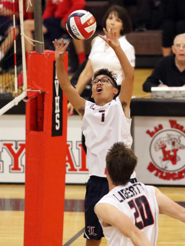 Liberty's Brycen Ivester, top, sets up Mike Meatovich during the boys volleyball Sunrise Region tournament quarterfinals against Rancho at Las Vegas High School Tuesday, May 5, 2015, in Las Vegas. ...