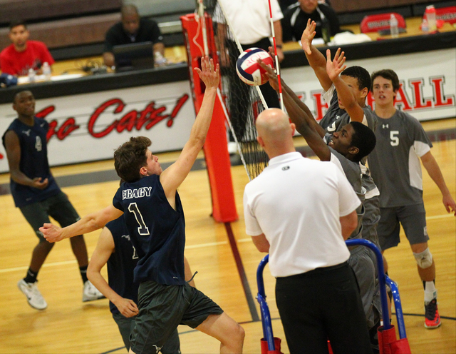 Legacy's Tanner Compton (1) sends the ball over the net against Arbor View during a Sunset Region boys volleyball semifinal match on Thursday. The Longhorns defeated the Aggies, 3-1. (Chase Steven ...