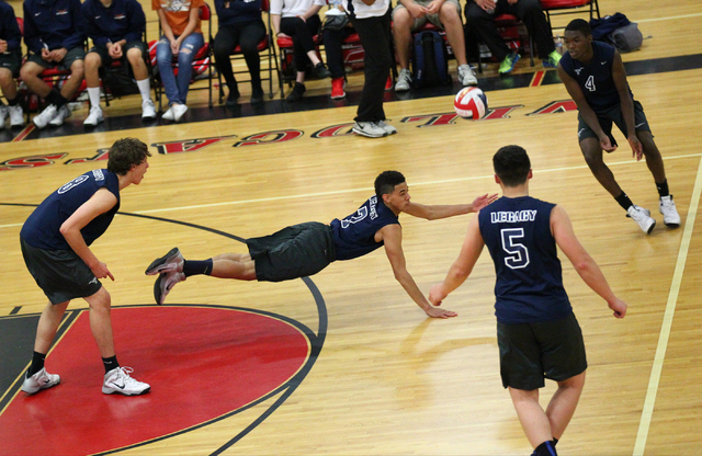 Legacy's Anthony Madden (7) dives to make a dig as Trent Compton (8), Braden Liu (5) and Zaire Franklin (4) look on during a Sunset Region boys volleyball semifinal match on Thursday. The Longhorn ...