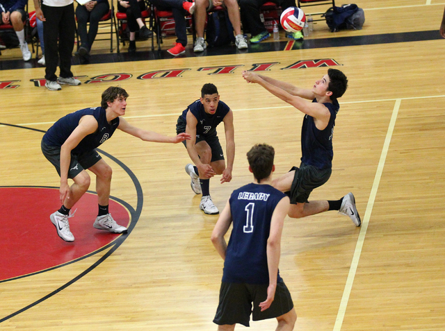 Legacy's Jonah Tarlton, right, receives the ball from Arbor View as, from left, Trent Compton, Anthony Madden and Tanner Compton look on during a Sunset Region boys volleyball semifinal match on T ...