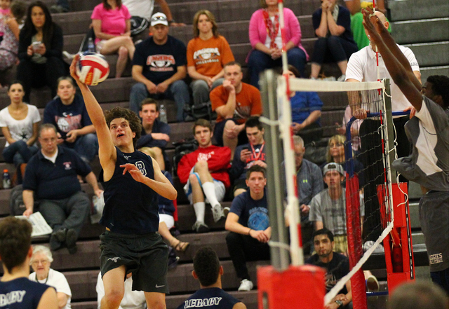 Legacy's Trent Compton (8) goes for a kill against Arbor View during a Sunset Region boys volleyball semifinal match on Thursday. Compton had 15 kills as the Longhorns defeated the Aggies, 3-1. (C ...