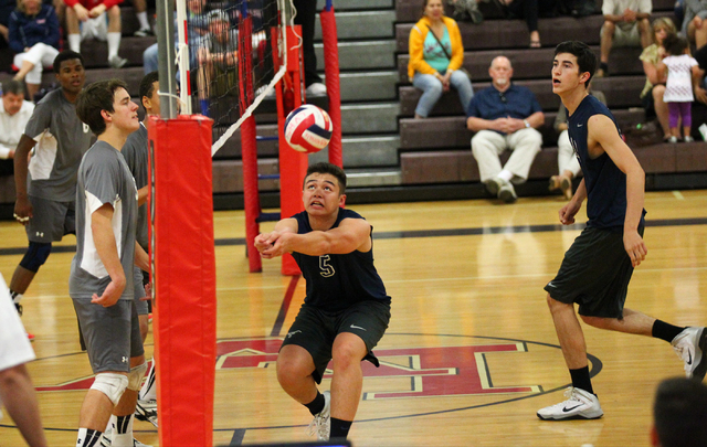 Legacy's Braden Liu (5) passes the ballduring a Sunset Region boys volleyball semifinal match on Thursday. Liu had 42 assists and five digs as the Longhorns defeated the Aggies, 3-1. (Chase Steven ...