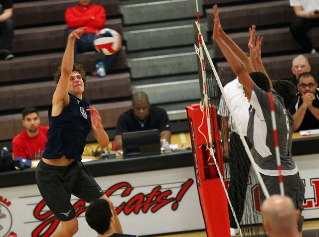 Legacy's Trent Compton goes for a kill against Arbor View during a Sunset Region boys volleyball semifinal match on Thursday. Comton had 15 kills and eight digs as the Longhorns defeated the Aggie ...