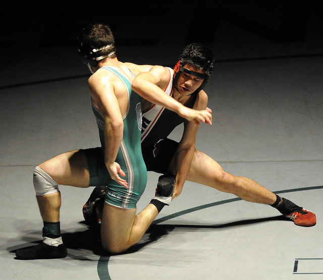 Las Vegas High's Alii Stewart, left, tries to take down Green Valley's Jiar Meagher of Green Valley during the 160-pound final of Sunrise Region Wrestling tournament at Green Valley High School in ...