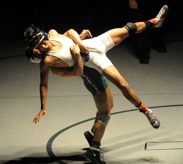 Green Valley's Sean Cannon slams Liberty's Michael Martinez to the mat during the 132-pound final of Sunrise Region Wrestling tournament at Green Valley High School in Henderson, Saturday, Feb. 07 ...