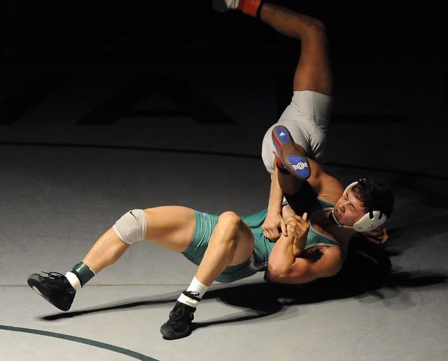 Green Valley's Sean Cannon wrestles Liberty's Michael Martinezto the mat during the 132-pound final of Sunrise Region Wrestling tournament at Green Valley High School in Henderson, Saturday, Feb.  ...