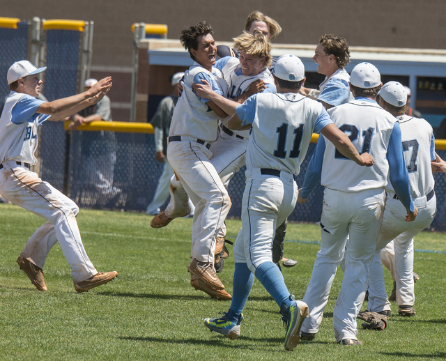 Centennial players celebrate their 8-4 victory over Bishop Gorman in the Sunset Region baseball championship game at Centennial High School in Las Vegas on Saturday, May 14, 2016. Jacob Kepler/Las ...