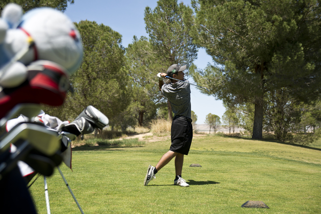 Palo Verde's Jun Oshimoto hits his ball during the Sunset Region boys golf tournament at the Primm Valley Golf Course on Wednesday, May 11, 2016. Daniel Clark/Las Vegas Review-Journal Follow @DanJ ...