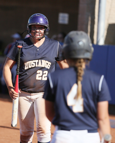 Shadow Ridge's Kate Dennis, left, smiles to teammate Sofia Meza, right, after scoring a run in a first round of the Sunset Region tournament game against Bishop Gorman on Tuesday. Bishop Gorman wo ...