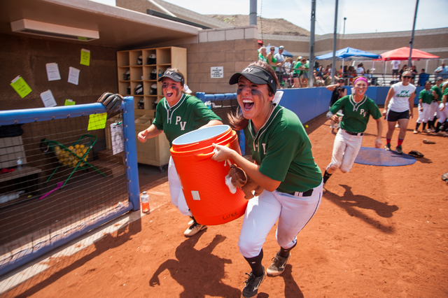 Palo Verde players Rachael Turner, left, and Rachel Williams grab a hold of the gatorade cooler as they look for their coach Kelly Glass after their Sunset Region championship game win against Cen ...