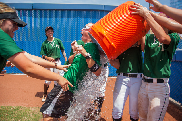 Palo Verde players give their coach Kelly Glass, center, the winning water bath after their Sunset Region championship game win against Centennial at Bishop Gorman on Saturday. Palo Verde won the  ...