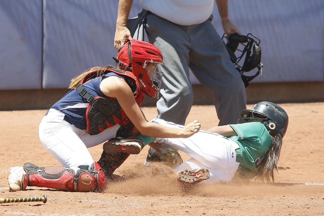 Alexa Lira of Rancho slides into home but is tagged out by Liberty on May 14, 2016, at Bishop Gorman High School in Las Vegas. Rancho won the game 8-0, making them the 2016 NIAA Division I Sunrise ...
