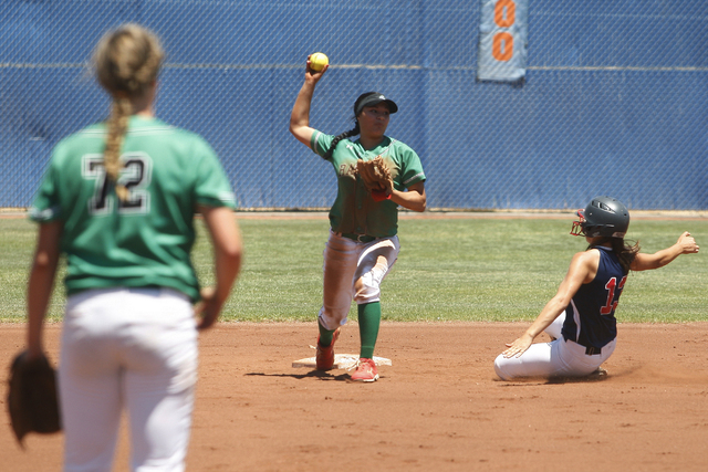 Tiare Lee of rancho catches the ball and throws it back to first as Ashleigh Rodriguez of Liberty slides into second, getting her out, on May 14, 2016, at Bishop Gorman High School in Las Vegas. R ...