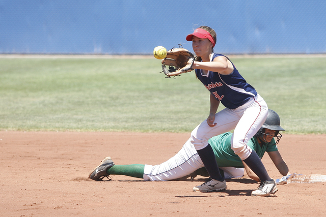 Lili Gutierrez of Rancho safely slides back into second after an attempted steal against Liberty at Bishop Gorman High School in Las Vegas on May 14, 2016. Rancho won the game 8-0, making them the ...