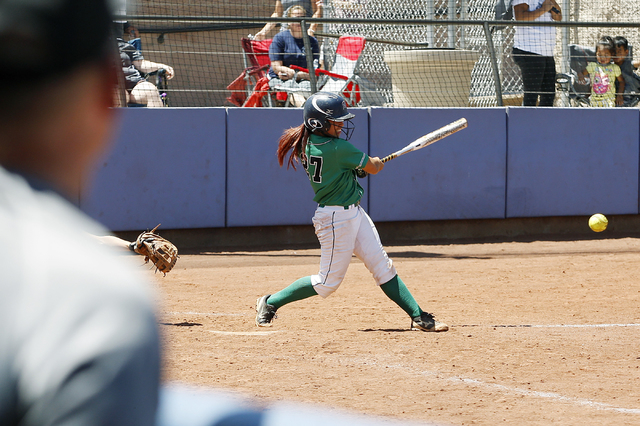 Katerina Anthony of Rancho hits the ball against Liberty in their softball game at Bishop Gorman High School in Las Vegas on May 14, 2016. Rancho won the game 8-0, making them the 2016 NIAA Divisi ...