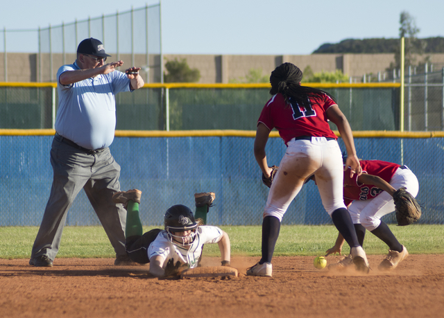Rancho's Gianna Carosone (66) tags third base during the Sunrise Region softball tournament final against Coronado at Foothill High School on Thursday, May 12, 2016. Rancho won the game in the eig ...