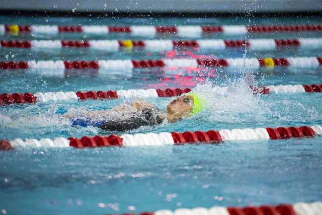 Abby Richter of Green Valley swims during the girls 100 yard backstroke final of the Sunrise Region swim meet at the Bucky Buchanan Natatorium on the campus of UNLV in Las Vegas on Saturday, May 1 ...