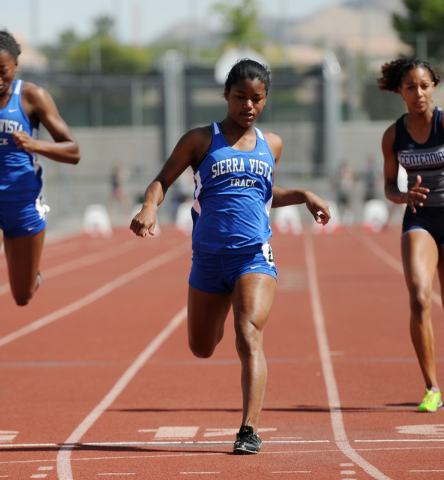 Sierra Vista's Morgan O'Neal, center, competes in the 100-meter dash at the Sunset Region meet on Saturday. O'Neal won the event in 12.46 seconds. (Erik Verduzco/Las Vegas Review-Journal)